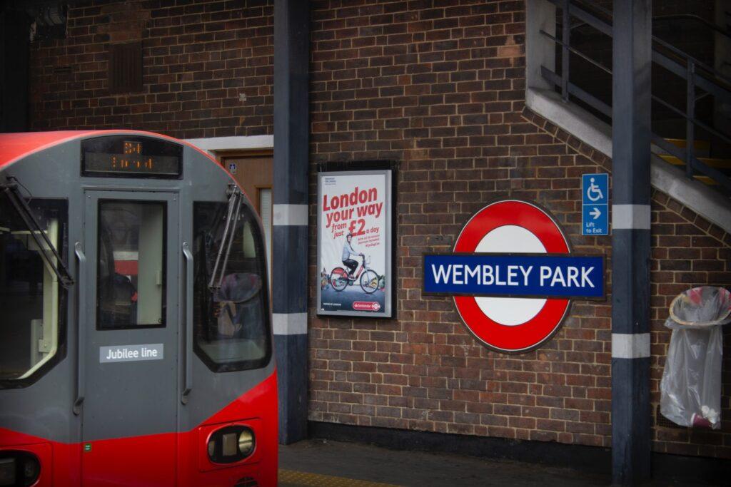 gray and red train at wembley park